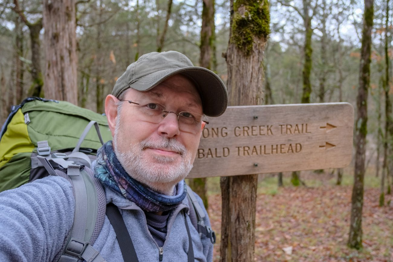 Photograph of Gary Allman at the Rock Spring (Long Creek) and Devil's Den West (Lower Pilot) Trails at Hercules Glades Wilderness, Mark Twain National Forest. March 2019.