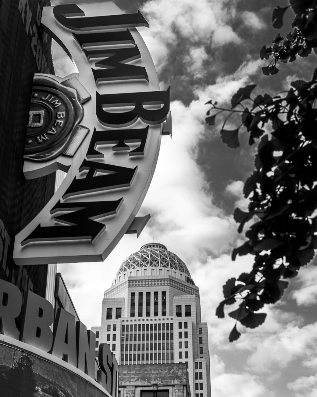Black and white photograph of a Jim Beam sign. Louisville, Kentucky.