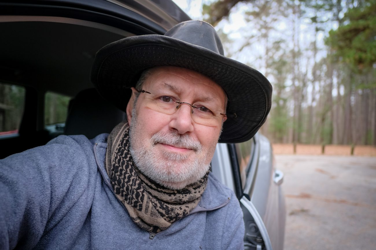 Color photograph of Gary Allman in his vehicle parked in the Berryman Campground parking lot, having completed hiking the 26 mile Berryman Trail, in Missouri, USA. December 2020.