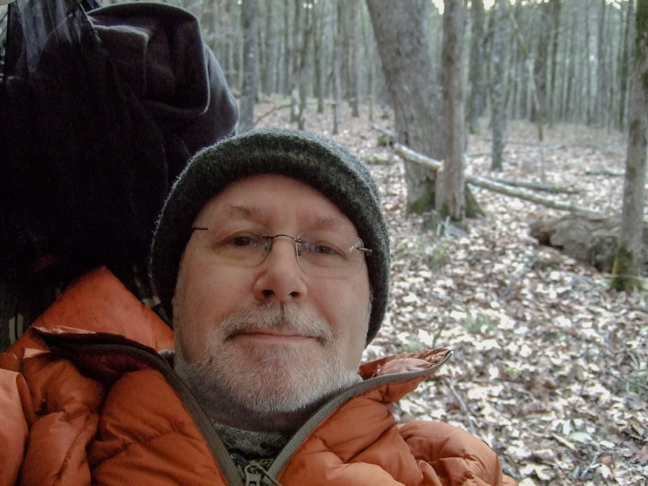 Color photograph of Gary Allman reclining in a Dutchware Chameleon hammock, Hercules Glades Wilderness, Missouri, USA. December 2020.