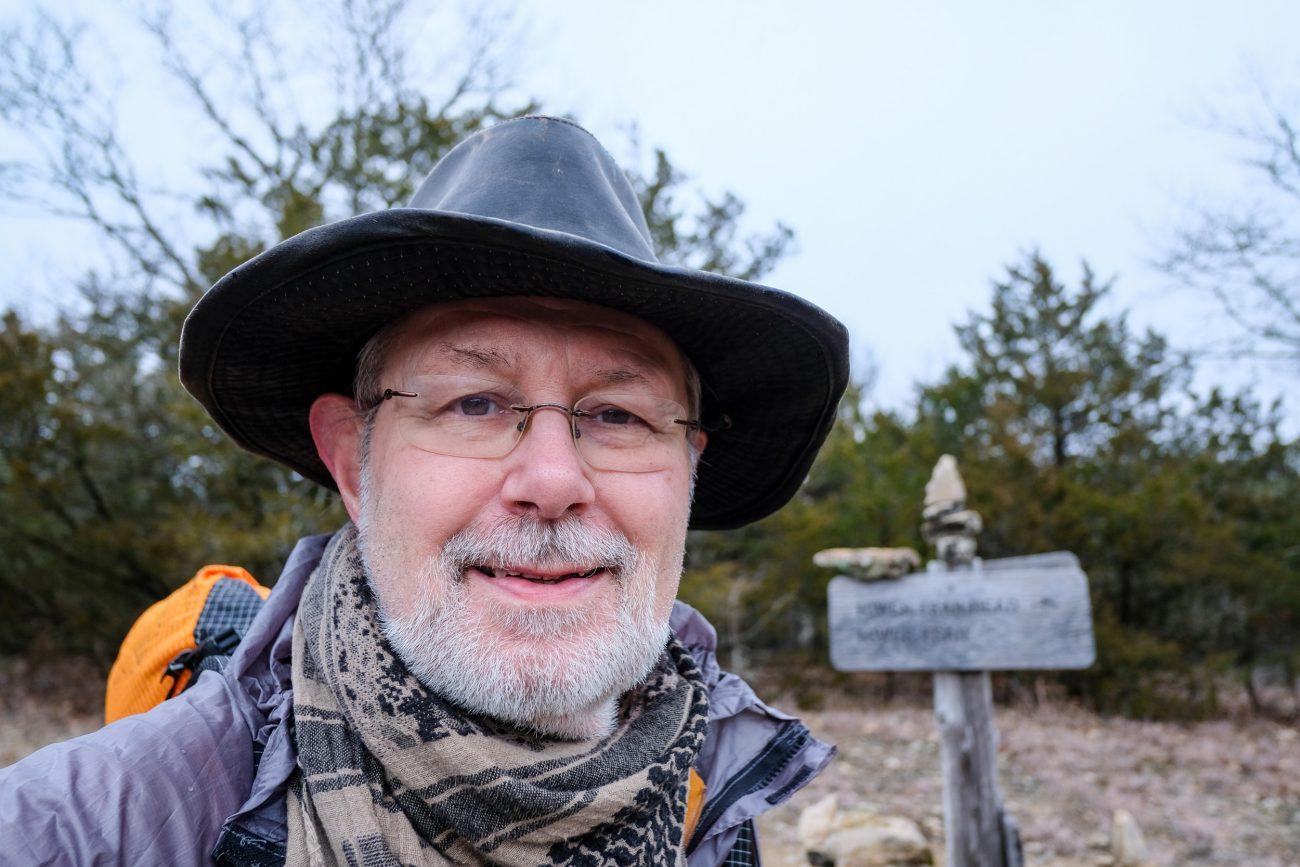 Color photograph of Gary Allman by the Pole (Pete) Hollow Trail Cairn, Hercules Glades Wilderness, Missouri, USA. January 24, 2021.